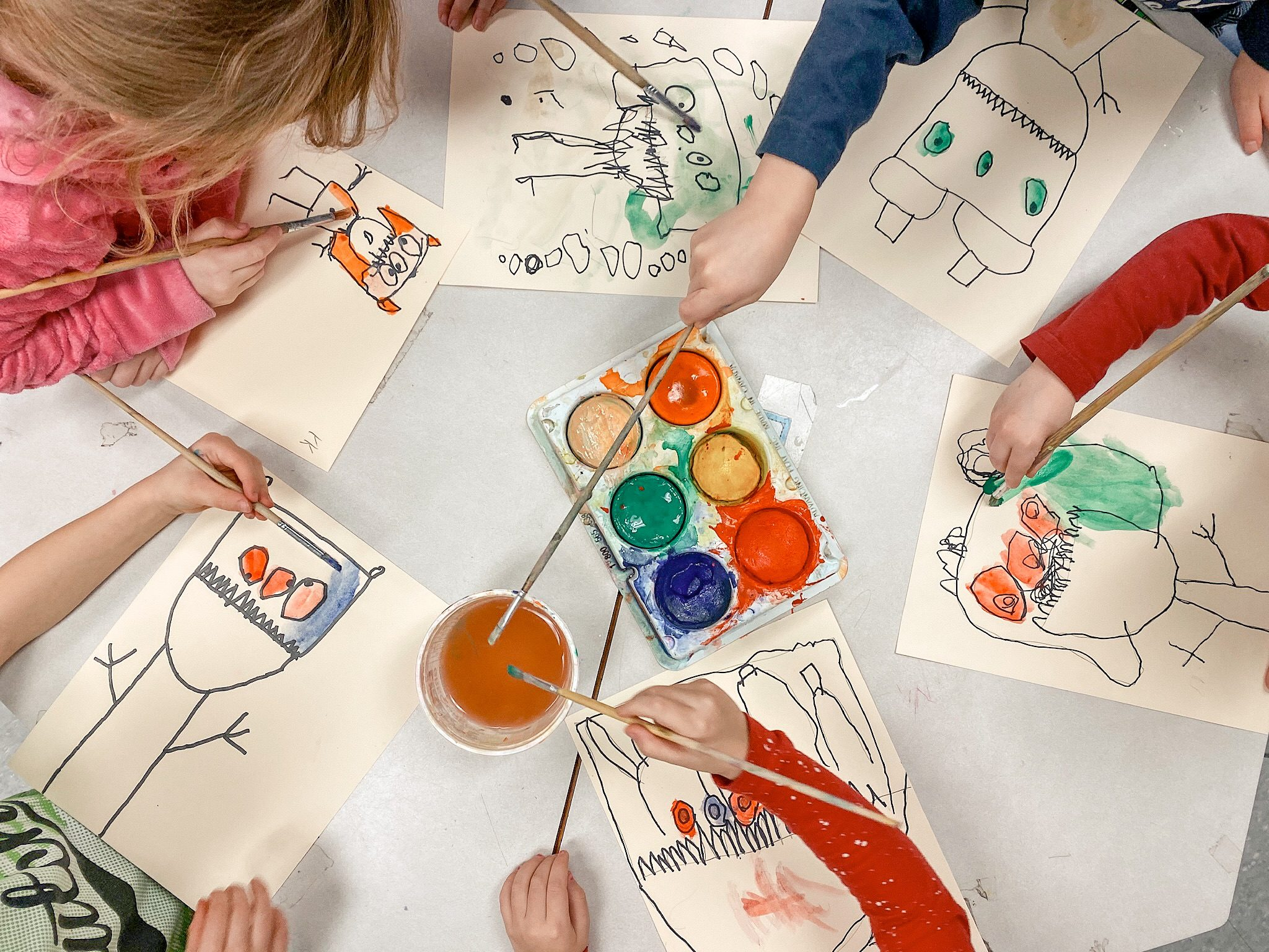 Kindergarten students doing an art activity. They are working on directed drawings.